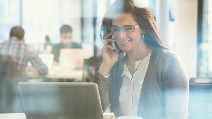 Work_Life_Matters_Woman_Using_Phone_At_Work
