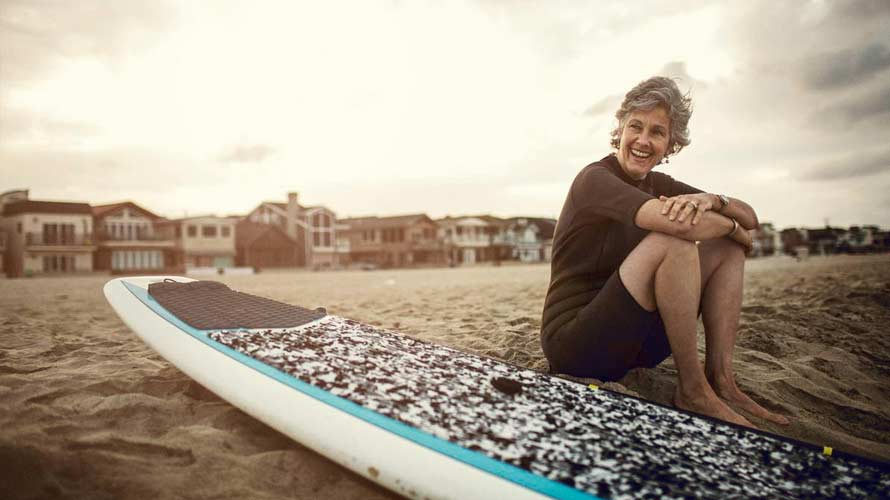 Universal_Life_Insurance_Woman_With_Surfboard