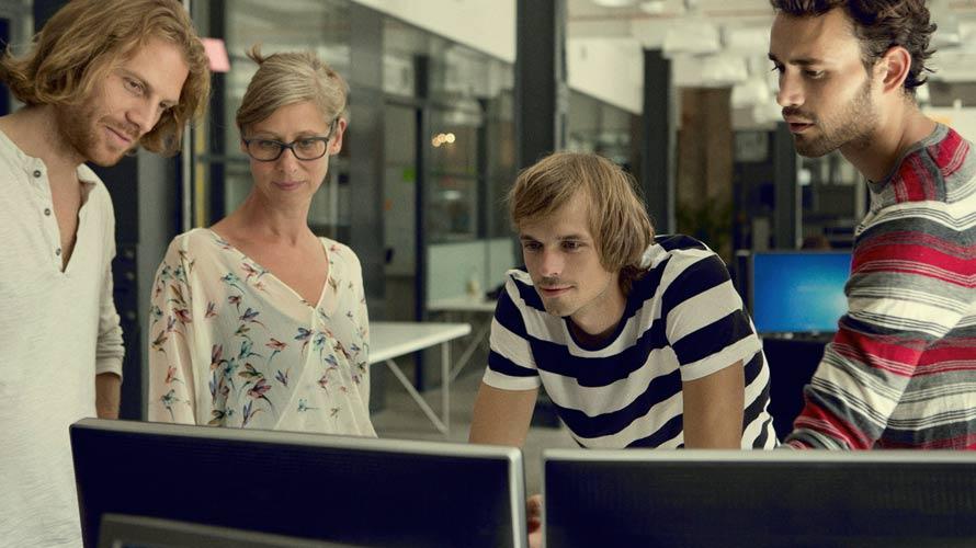 Finding_A_Satisfying_Career_Group_Looking_At_Desktop
