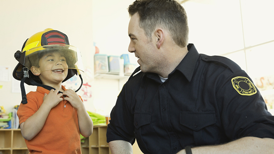 Giving_To_Charity_Boy_Wearing_Firefighter_Hat
