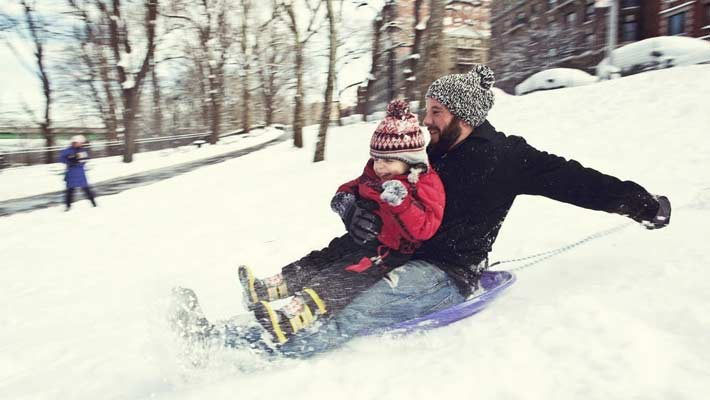 Life_Insurance_Dad_And_Son_Sledding