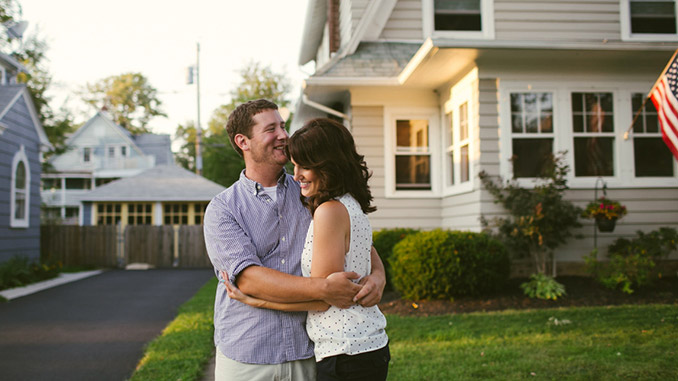 Married_Couple_Hugging_Outside_Home