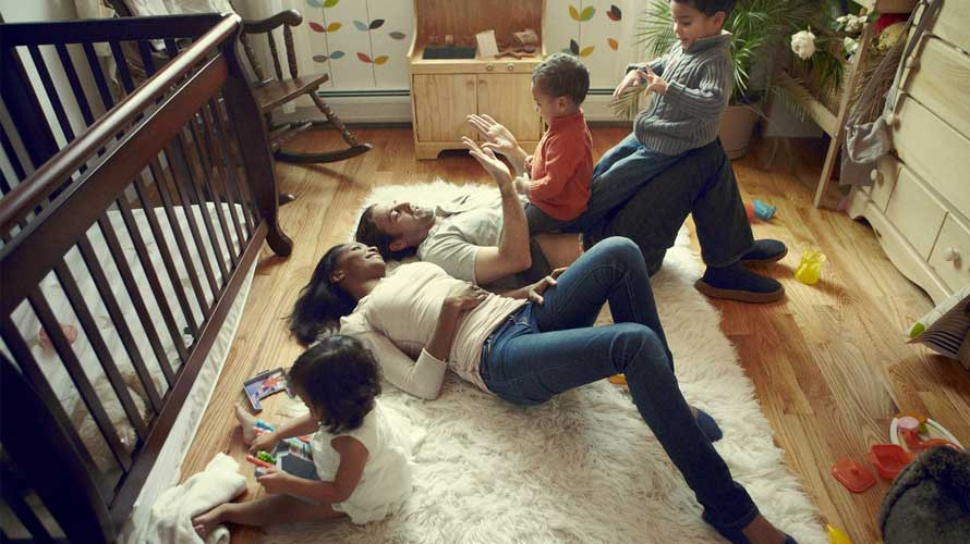 Term_Life_Insurance_Happy_Family_Laying_On_Floor