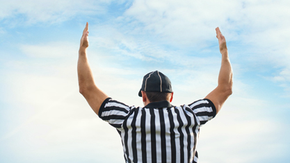 football_referee_signaling_touchdown