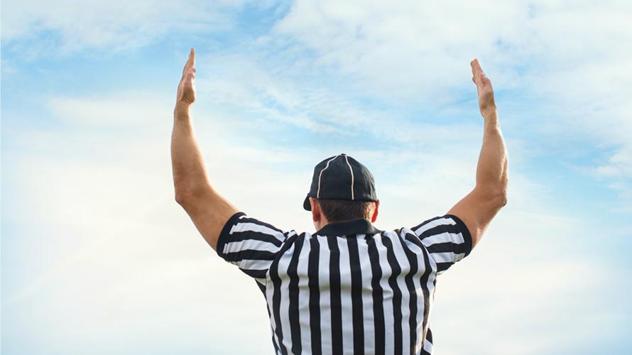 football_referee_signaling_touchdown