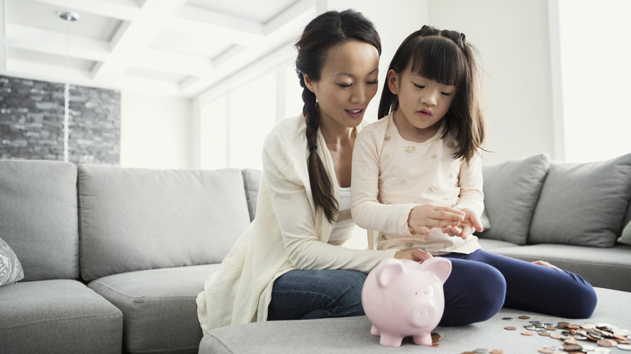 Mother-and-Daughter-Counting-Piggy-Bank