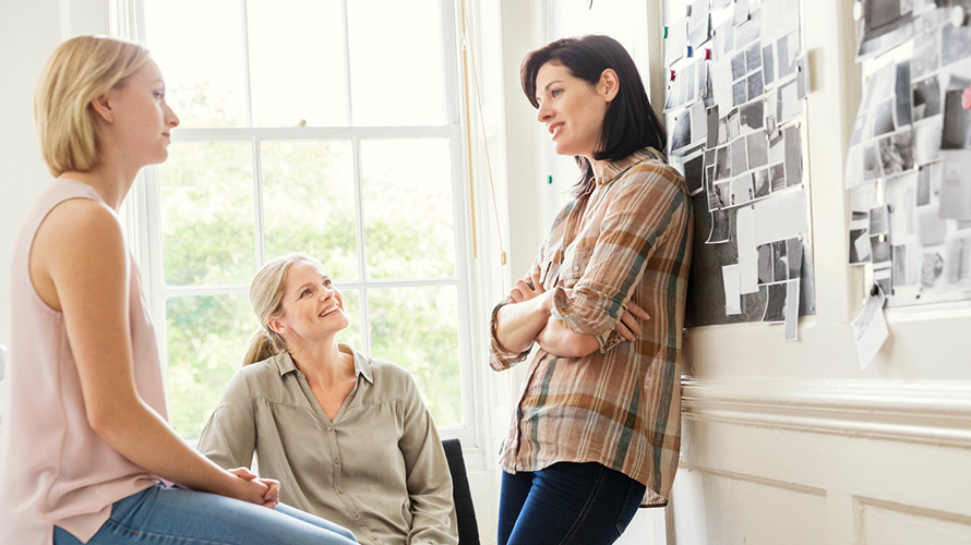three_women_chatting_in_a_meeting